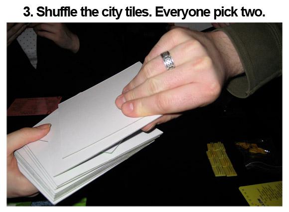 3. Shuffle the city tiles. Everyone pick two.